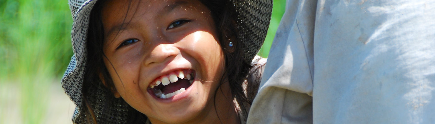 Header: Smiling Khmer girl in rice field