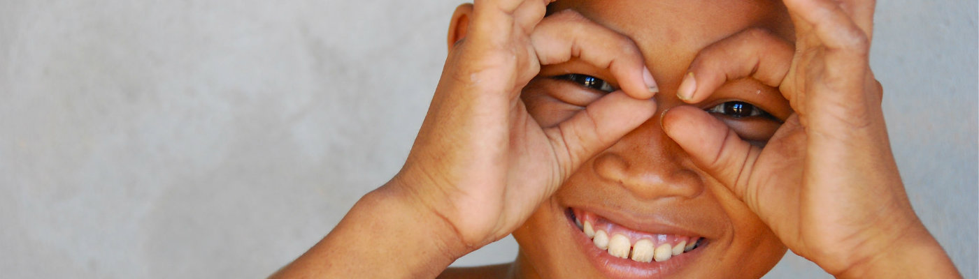 Header: Smiling Khmer boy