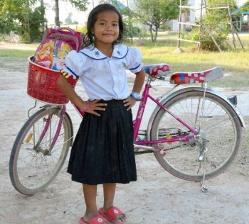 Young student with her new bicycle
