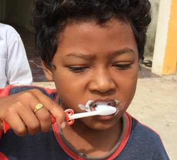 Young boy brushing his teeth