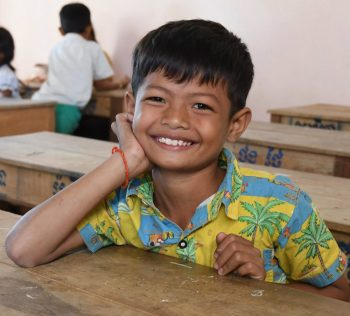 Smiling boy in RSP classroom